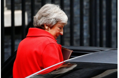China British PM vows to move on with her Brexit plan company